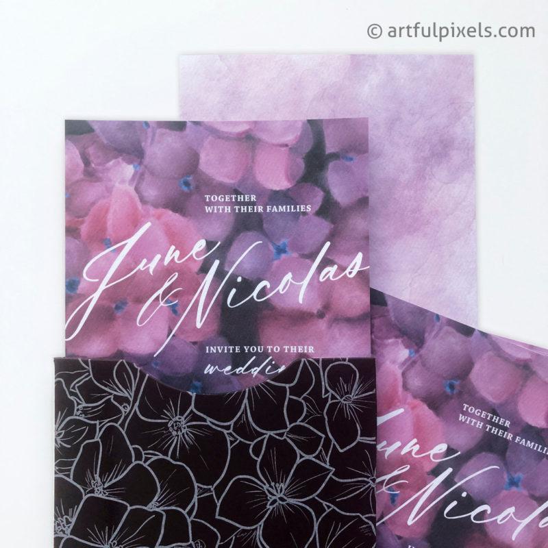 Floral wedding invitation inside black pocket